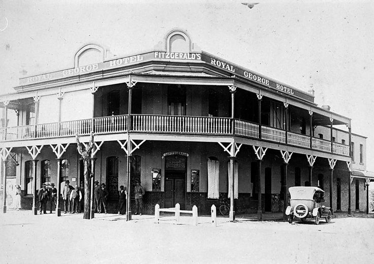A group in front of Fitzgerald 's Royal George Hotel inDonald, Victoria, 1926 - Museum Victoria. Built by J.A. Meyer about 1876.