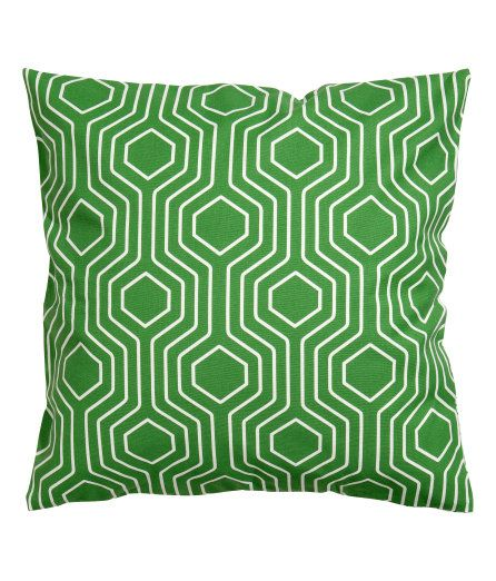 Green geometric cushion cover from H&M.