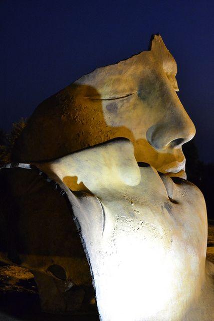 Sculpture by Igor Mitoraj amidst the ruins in the Valle dei Templi, Agrigento, Sicilia, Italia.