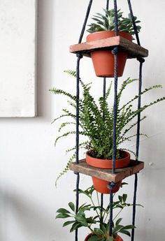 This is a throwback design but still a good one for those spaces indoor or out.  Would be fun if the wood and containers were painted in coordinating colors too.  The rope is easy to dye/paint to match or just use white.  Nylon rope comes in a lot of colors or one could use para chord too which comes in a slew of colors.