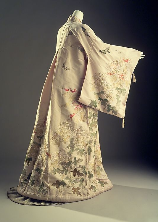 1910 - c Kimono (attributed) Iida & Co./Takashimaya (Japanese, founded 1831) Japonisme reflected the influence of Japanese art and design on the West. This evening robe illustrates the confluence of the two cultures; its classic kimono silhouette is Westernized through the inclusion of a center-back pleat construction.