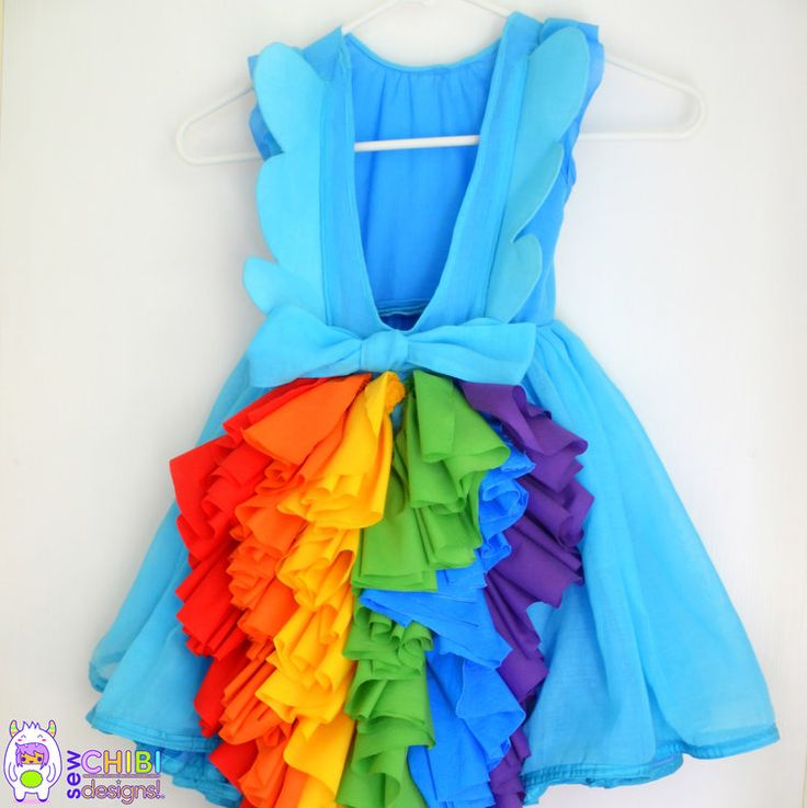 I recently made my daughter a Rainbow Dash birthday dress for her upcoming  birthday. As per her request, her dress had two super fun elements that I  want to share with you all: a modest set of wings added to a back bodice  and a cascading ruffle tail! This will be perfect for any birthday dress  and a great added touch to those Halloween outfits that we'll all be  toiling away on soon enough!!