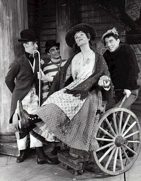"""Julie Andrews and cast from My Fair Lady. In this scene, Eliza and her friends dream of a better life-""""Wouldn't It Be Loverly?"""","""