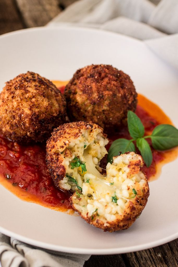 Arancini Di Riso with Balsamic Vinegar and Caramelized Onions Marinara Sauce   www.oliviascuisine.com   These risotto balls stuffed with cheese are an easy and delicious Italian antipasto! The recipe includes a basic parmesan risotto recipe, but you can absolutely use leftover risotto.