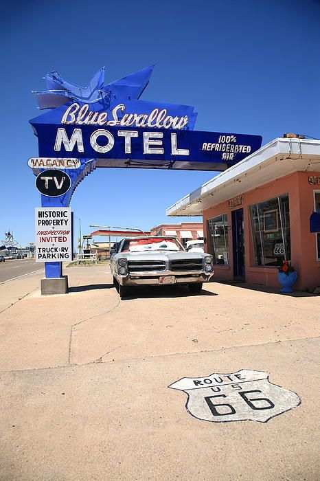 "Route 66. Blue Swallow Motel in Tucumcari, New Mexico, on old Rt. 66. The classic neon sign was recently repainted in its original colors. ""The Fine Art Photography of Frank Romeo."""