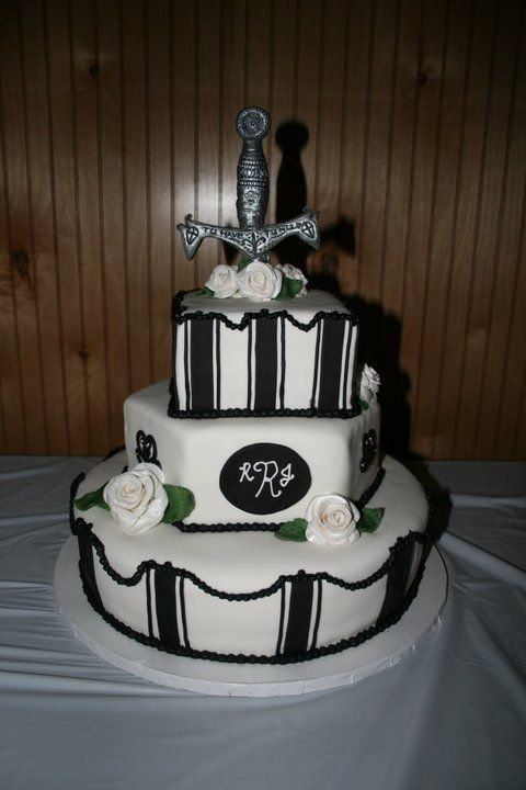 Medival sword wedding cake - All decorations are made out of gumpaste