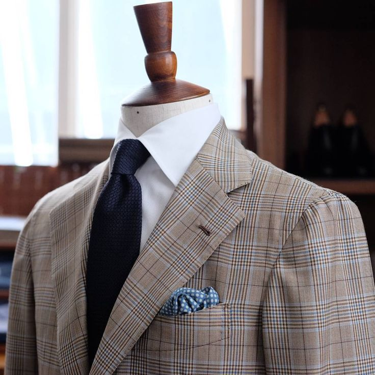 Beige glen plaid jacket, white shirt, navy knit tie