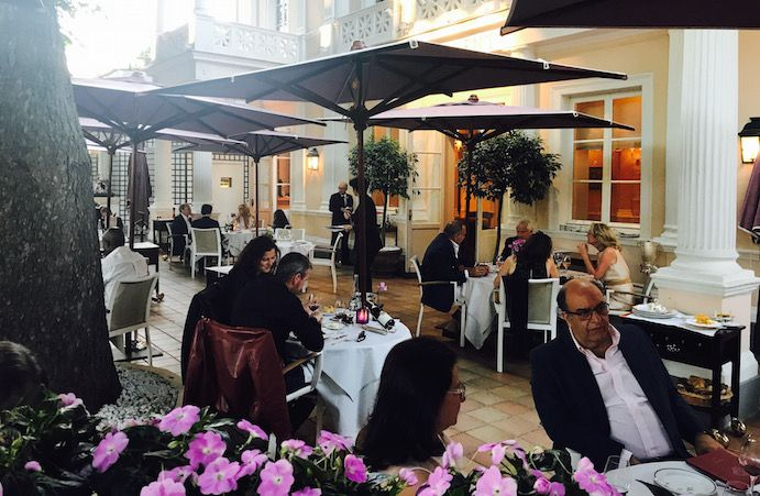 Summer night dining on the terrace of Michelin restaurant Le Laurent in Paris, France