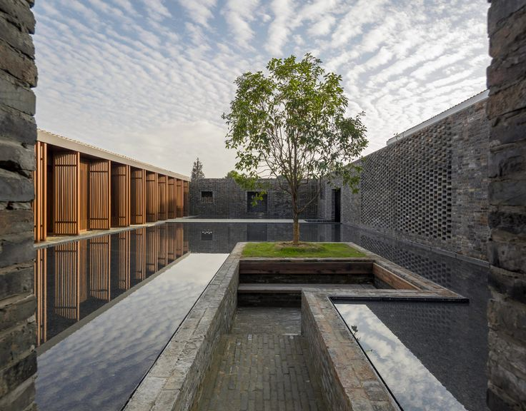 Chinese studio Neri&Hu has completed a boutique hotel in Yangzhou comprising a grid of dark-brick walls that surround a series of courtyards, gardens, guest rooms and service areas.