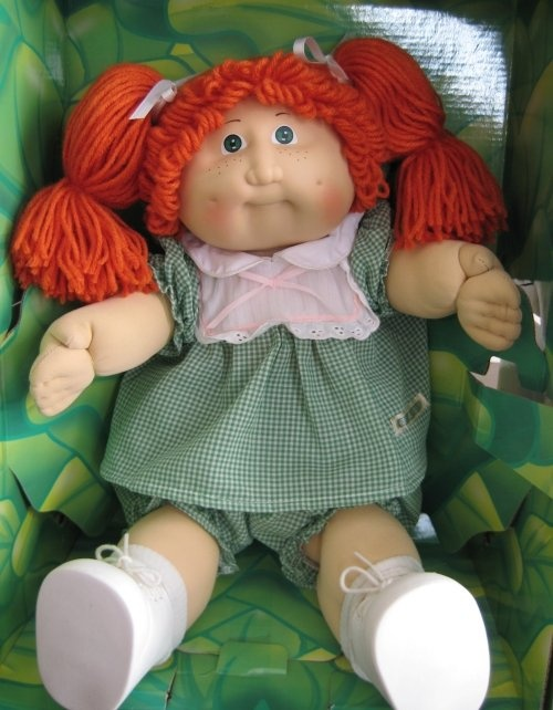 """Cabbage Patch Kids - Back in the early 80s, these dolls were like the """"Tickle Me Elmo"""" dolls in the 90s. Parents fought over them in the stores, and you were not cool unless you had at least one. I finally got my first one for Christmas in 1984. Looked like this one, but the hair was blonde. Her name on the adoption certificate was """"Fawn Leotine""""."""