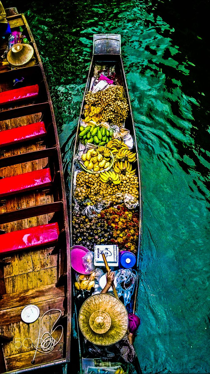 We adore this vibrant photo of exotic fruits, at Bangkok floating market in…