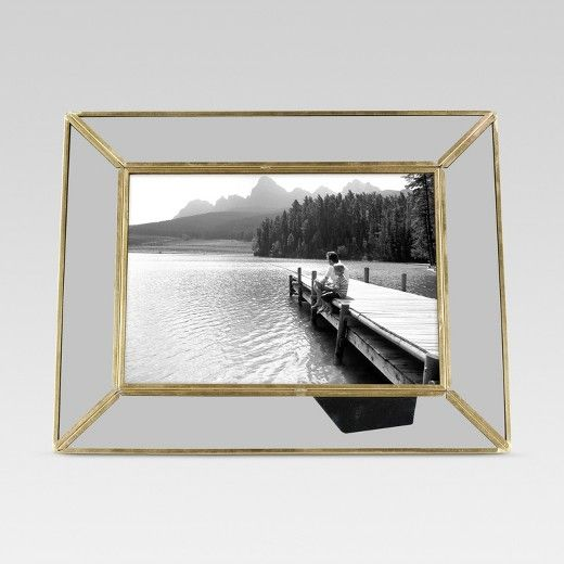 Bring a pop of contemporary style to your home or apartment with this Single Image Frame from Threshold™. This brass and glass picture frame features a bright, shiny gold accent around the gray-tinted glass frame for a pop of easy, bold style. Use this picture frame to protect and display your most cherished memories around your home. Place this contemporary picture frame with gold metal accents on a shelf, end table or mantel for a great decorative accent piece.