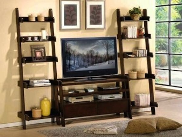 angled ladder bookshelve around tv | originally posted by kerri girouard