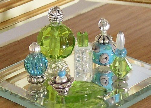 DIY Perfume Bottle Idea - They are actually glass, metal and acrylic beads glued together!