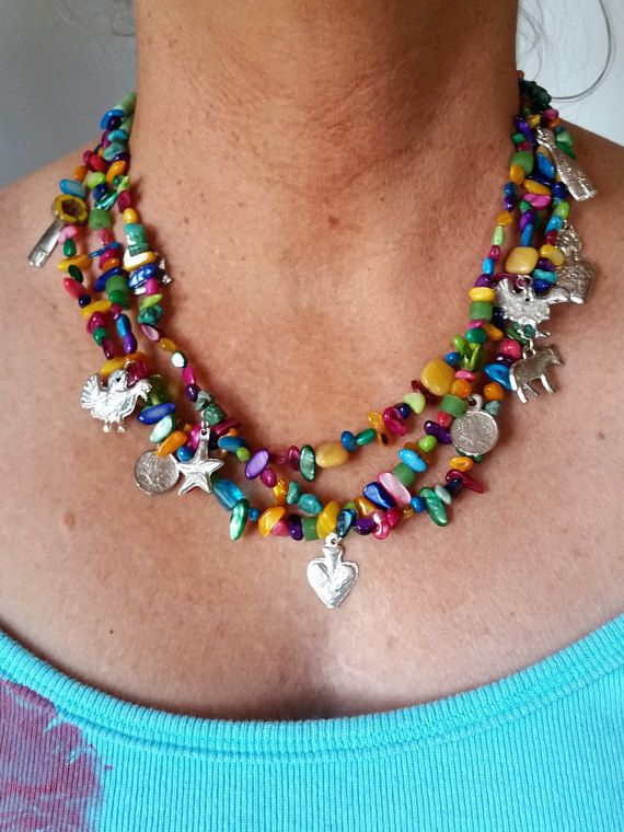 Necklace Name: Summer of Milagros (miracles) This necklace will jazz up any outfit this summer with its rainbow of colorful beads and many shapes of shiny silver milagros charms. It is adjusts from about 16 inches up to 30 inches. Necklace Elements: Peruvian Opals Yellow Opals