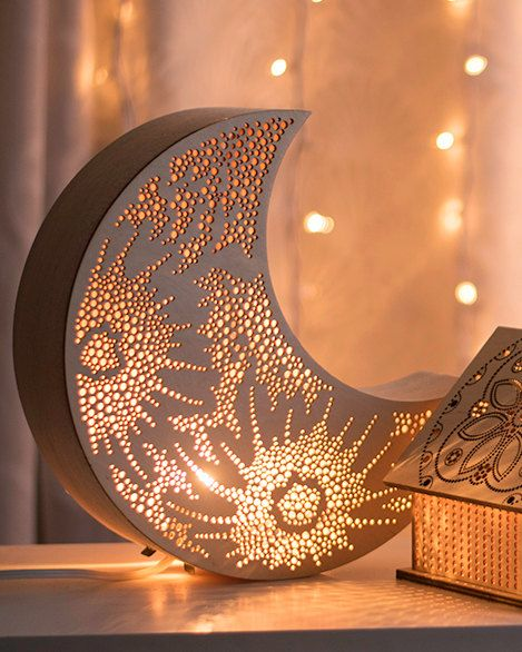 I N T E R N A T I O N A L C U S T O M E R S: The necessary adapters for your region will be included in your order. Contact me directly with any questions. -------------------- This crescent moon light is handmade with a hand-curved balsa rim. Laser-cut with an original crater