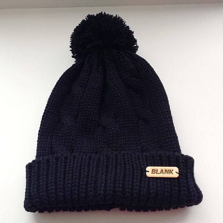 This Pom Pom toque is black, one size fits all, with a hand sown wooden label! Available at www.blankhatsforcharity.com