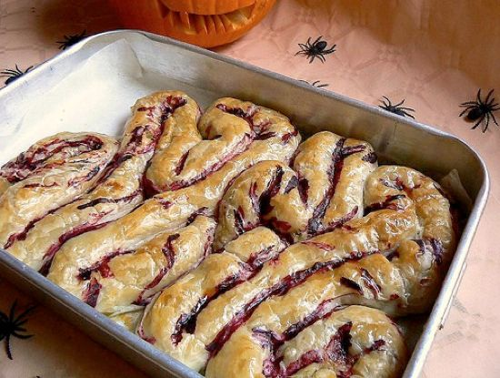 Intestine shaped Phyllo dough. Add some red food dye for blood and your favorite filling. A layer of red velvet cake would be cool underneath it!