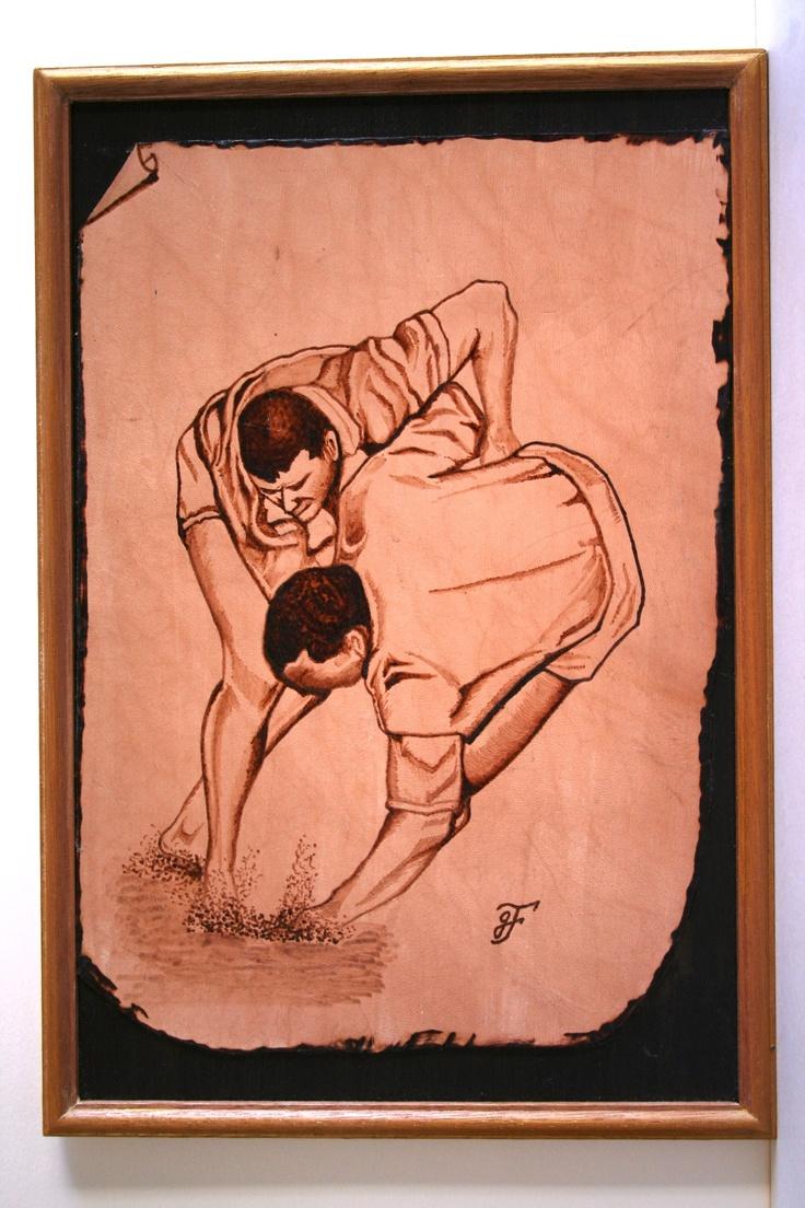 Lucha canaria, montado sobre madera, medidas 35 x 40 cm.