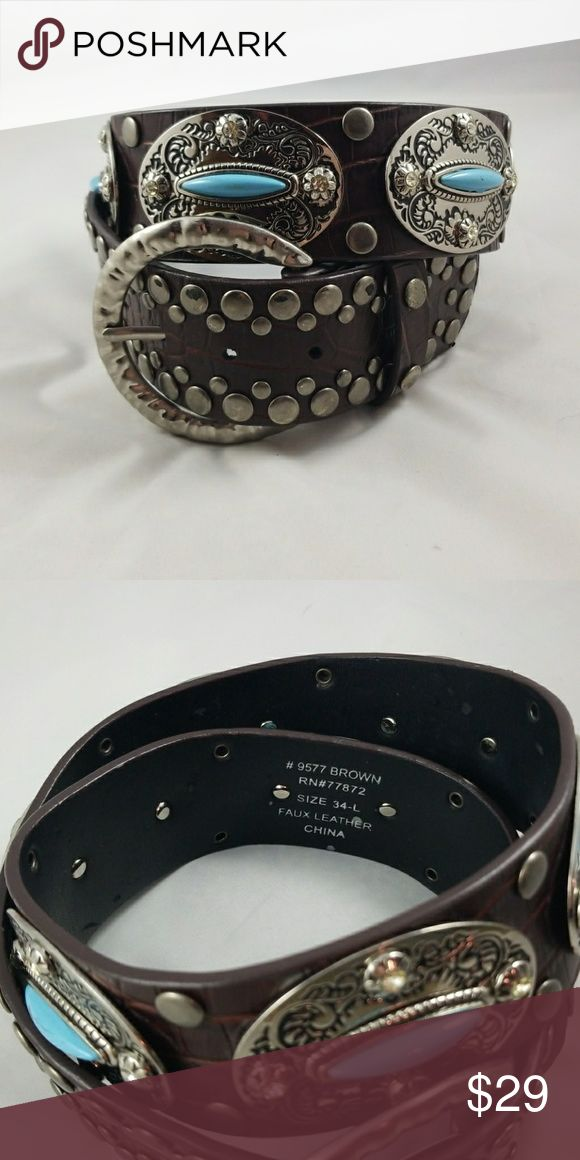 Western Style Belt 2 in wide dark faux leather belt with silver stud embellishments and silver with faux Turquoise ponchos. Heavy belt! Gently worn once or twice! Accessories Belts