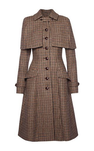 This **Lena Hoschek** Sherlock Harris Tweed coat features a pointed collar with a detachable cape and flared hem silhouette.