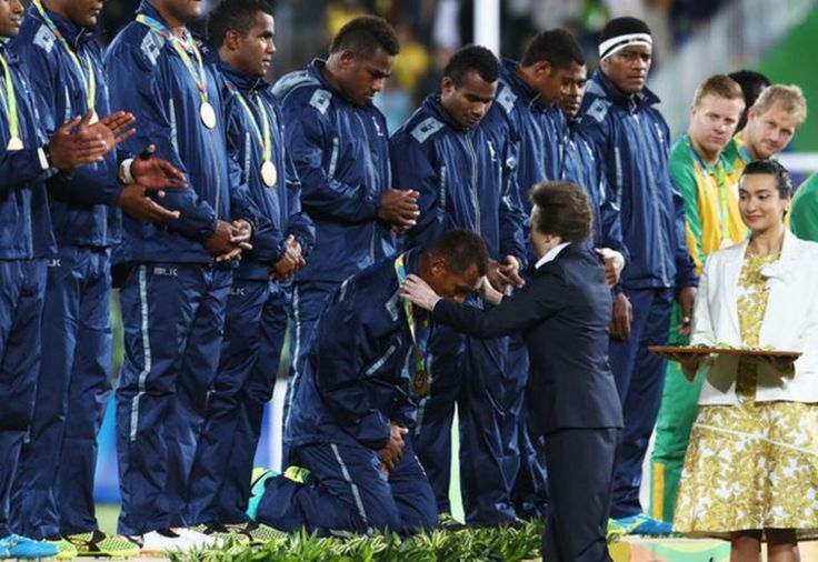 The Fiji players, renowned for both their humility and size, kneel to receive their medals from the Princess Royal Great Britain finished with silver in the inaugural men's rugby sevens as Fiji beat them 43-7 to claim gold - the country's first ever Olympic medal.
