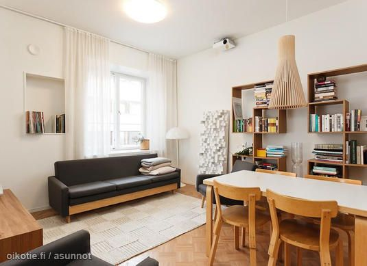 Scandinavian homes: Alvar Aalto dining chairs and table, Secto lamp