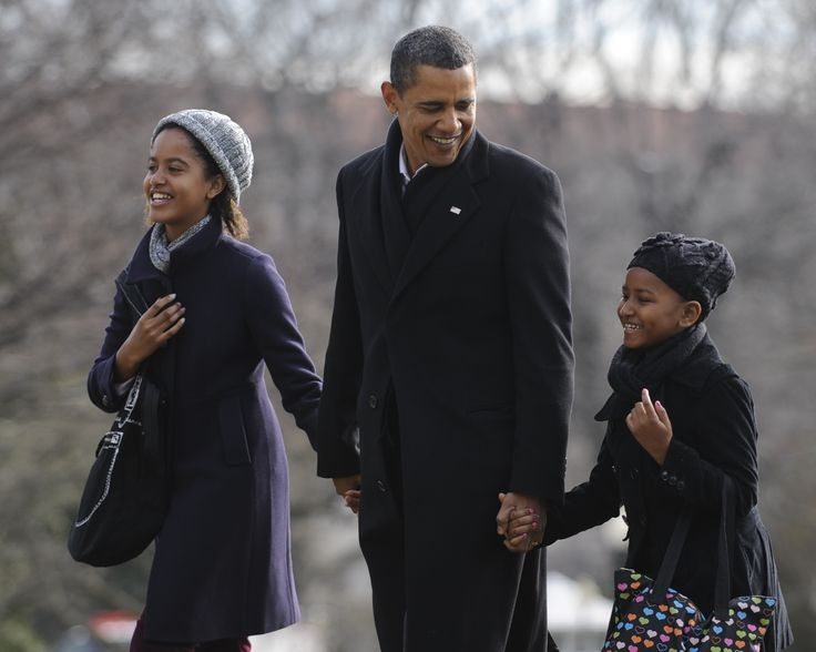 President Barack Obama holds hands with daughters Malia (L) and Sasha upon their return to the White House in Washington, following their vacation in Hawaii. (Photo by ImageCatcher News Service/Corbis via Getty Images) via @AOL_Lifestyle Read more: https://www.aol.com/article/entertainment/2017/01/24/malia-obama-turns-up-at-sundance-film-festival/21661923/?a_dgi=aolshare_pinterest#fullscreen