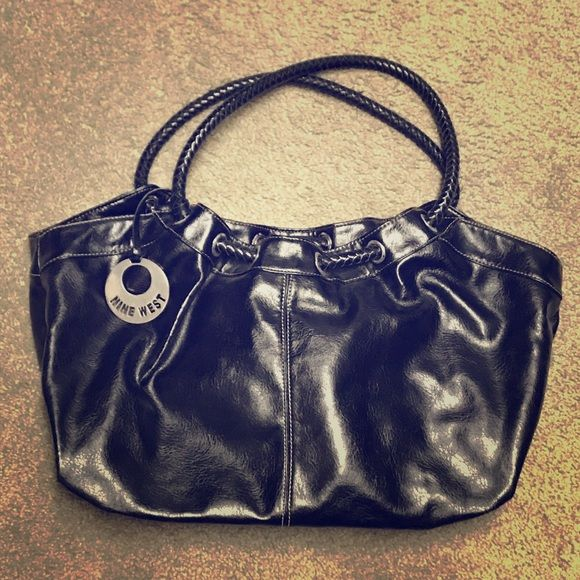 Shop Women's Nine West Black size OS Bags at a discounted price at Poshmark. Description: Oversized black leather Nine West purse. Great condition!. Sold by mrsbaurs. Fast delivery, full service customer support.
