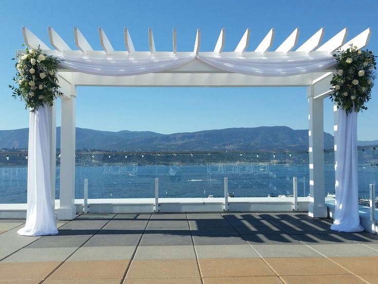 Wedding arbor draping and flowers