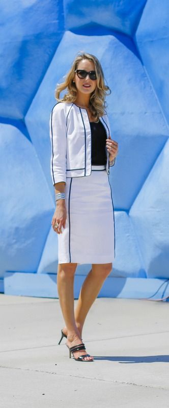 white linen skirt suit with black piping + black shell + strappy black slide backless sandals