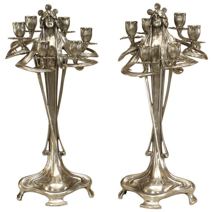 Pair of Silvered Art Nouveau Candelabra | From a unique collection of antique and modern candleholders and candelabra at http://www.1stdibs.com/furniture/lighting/candleholders-candelabra/