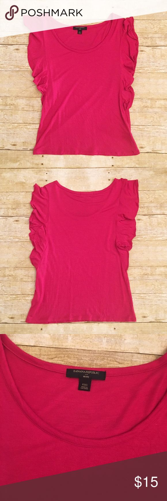 Pink Banana Republic ruffle short sleeve top, PXXS Very good used condition Banana Republic petite top. PXXS. Very soft(100%rayon). The ruffles as short sleeves is very flattering! Total length- approximately 21.5 inches, bust approximately 11 inches. Banana Republic Tops Tees - Short Sleeve