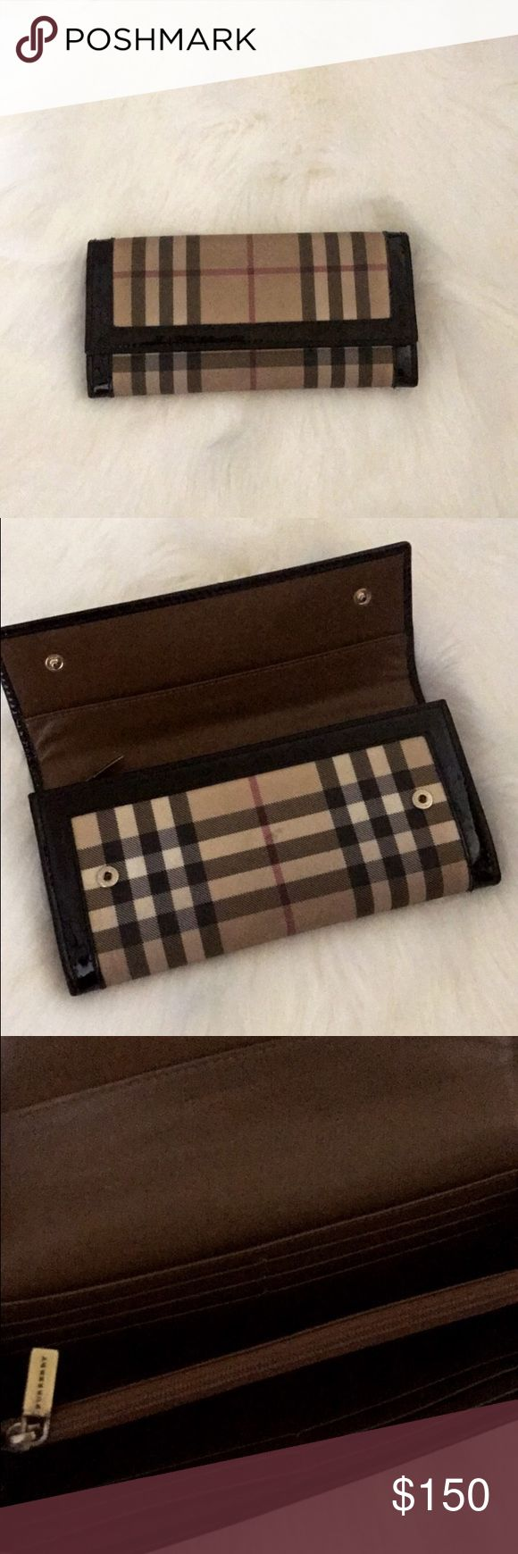 Burberry wallet Used Burberry wallet. Dirty but will clean prior to shopping. 16 card slots with a cash slide and coin purse. Burberry Bags Wallets