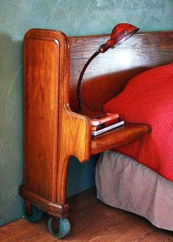 An interesting use of an old church pew!  Bed stands and a head board all built into one!