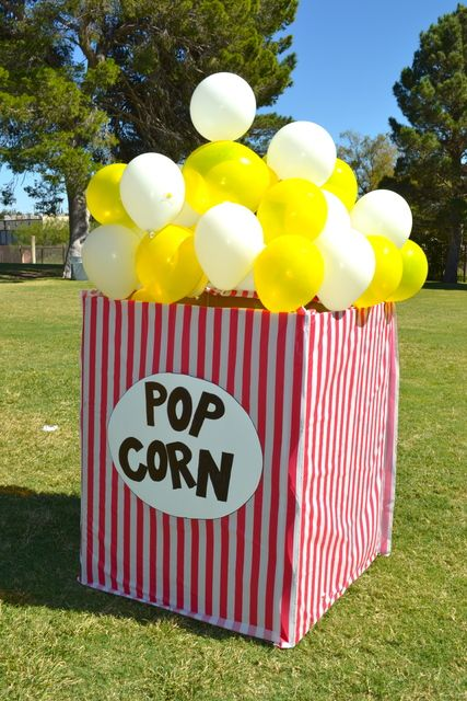 Giant popcorn box with balloons for a Movie Night or a Carnival themed fair