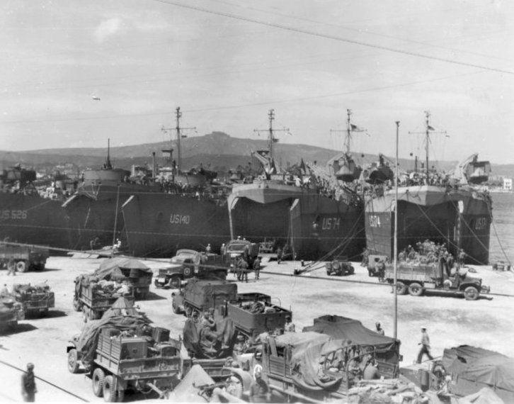 LST's line Naples' docks loading elements of VI Corps ...