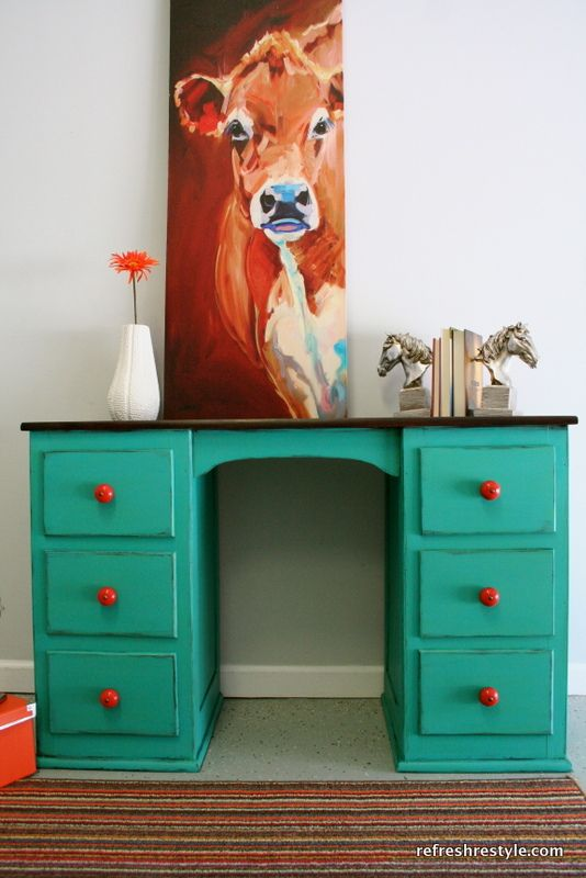 Turquoise desk, red knobs.