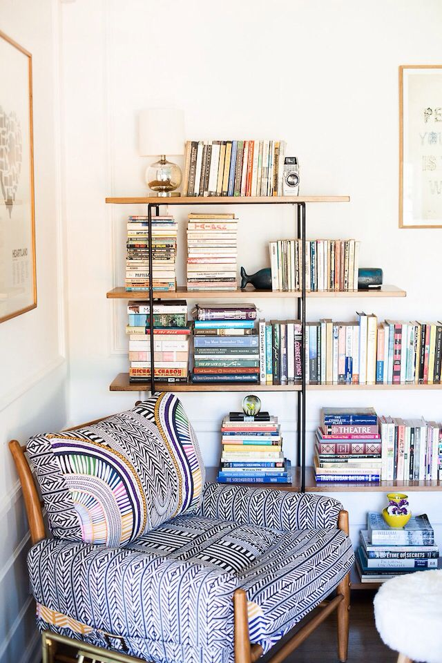 Love this as a reading nook idea in the corner of the living room by the brick wall. Fun chair.