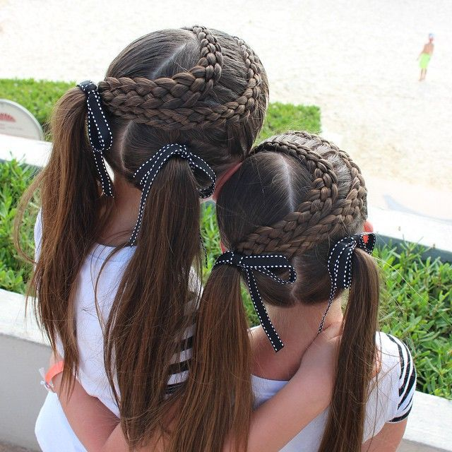 """Still more Mexico hair pics.  Two five strand lace braids wrapped around ending in two ponytails."""