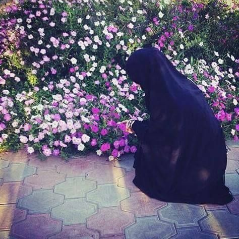 Kneeling by the Flower Garden