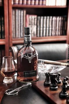 Okay, we're in. All that's here is Scotch & Cigars............& Bourbon, and oh look, a chess game is going on.................