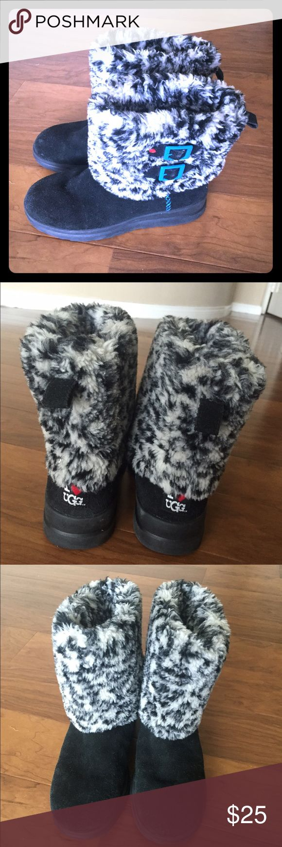I ❤️ UGG BOOTS!  Black and white Black suede foot with a furry black and white top around ankle area. Good used condition. Size 9 euro size 40 UGG Shoes Ankle Boots & Booties