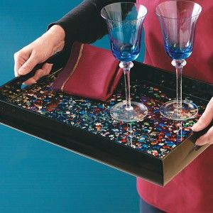 Save your broken glass ornaments and reuse them in the bottom of a recessed  serving tray