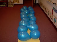 """The children will move a balloon (pretending to be Moses.) by answering a question from the story. After all the balloon have been moved and the """"Dry Land"""" is visible we will all walk through our version of the """"RED SEA."""""""