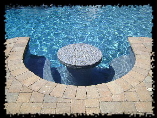 Pool that has a table with seating within it ... :)