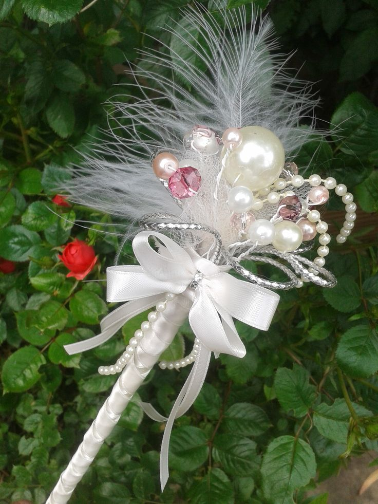 Fairy wand made from pearls and glass beads, trimmed with ivory satin ribbon!                                                                                                                                                                                 More