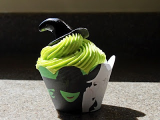 Wicked Cupcakes.   This site has the free printable cupcake wrapper.