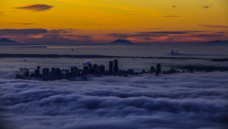vancouver city cover in fog temperature inversion - I tried to get images of the city covered in fog during a temperature inversion.  The first tie i went at night the road was closed so i went back for sunrise and got this image.