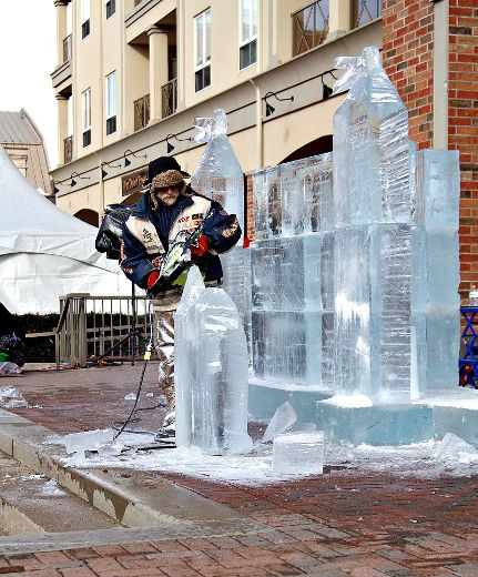 KARA WILSON, for The Expositor  Jean-Pierre Gauthier uses a chainsaw to sculpt details of an ice castle during Frosty Fest at Harmony Square.